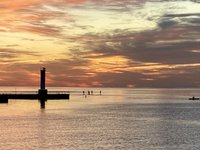 Paddle boarders beyond Oakville Harbour lighthouse