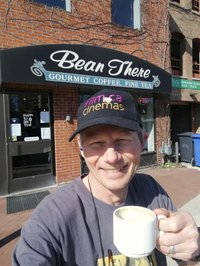 Brett Titus poses in front of Bean There Café