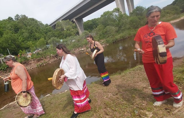 Local Indigenous community participate in healing ceremony on on the banks of Sixteen Mile Creek
