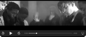 Thumbnail of Provida the Poet in the Weeknd's music video.