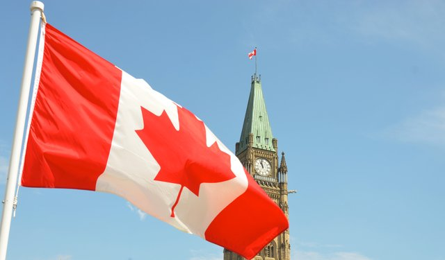 Canadian Flag with Parliament Hill Ottawa