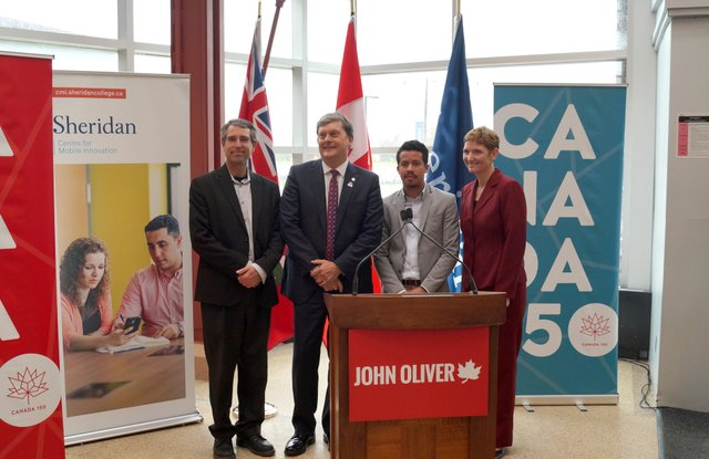 Dr. Ed Sykes, Professor of mobile computing and Primary Investigator; John Oliver, MP for Oakville; Enrique Ponce, Sheridan Student Union President and Dr. Janet Morrison, Sheridan's Provost and Vice President Academic, pose at the announcement event cele
