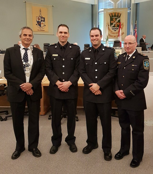 Halton Regional Chair Gary Carr, Primary Care Paramedic Adam Sellors, Primary Care Paramedic Justin Mlynaryk and Chief/Director of Paramedic Services Greg Sage