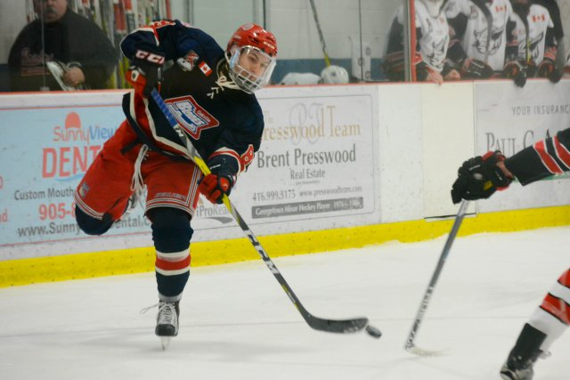 Jack Jeffers takes a shot during the first period of game one between Oakville and Georgetown.
