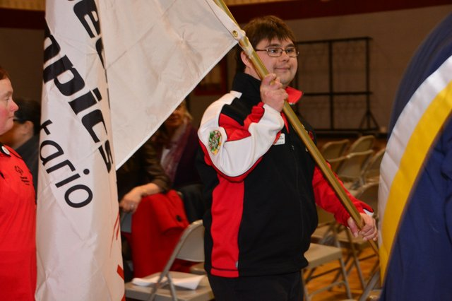 Special Olympic Athlete Andrew Beauchesne Carrying the Flag for Oakville