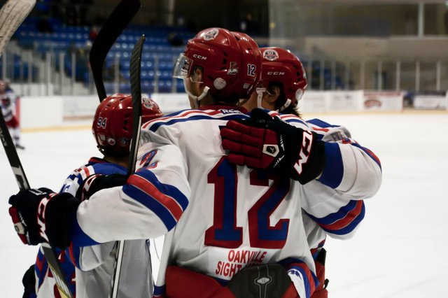 Ryan Foss celebrates with his linemates after scoring his second goal of the night against the North York Rangers.