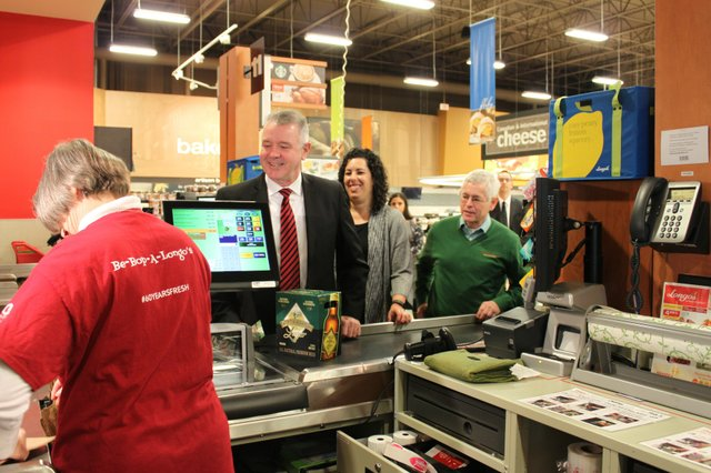 MPP Kevin Flynn buying beer at Longos