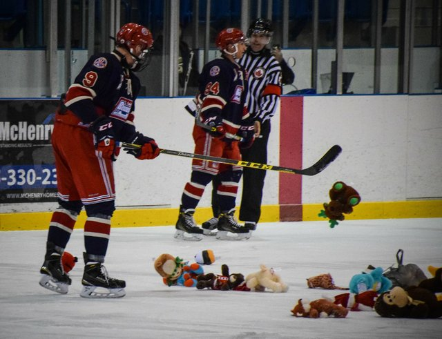 Cleanup work begins following Bryce Misley's goal that triggered Oakville';s second annual toy toss.