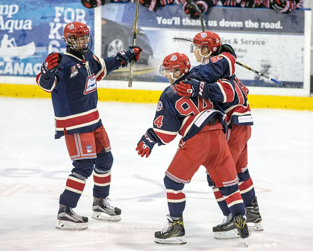 Bryce Misley #18 of the Oakville Blades celebrates with teammates