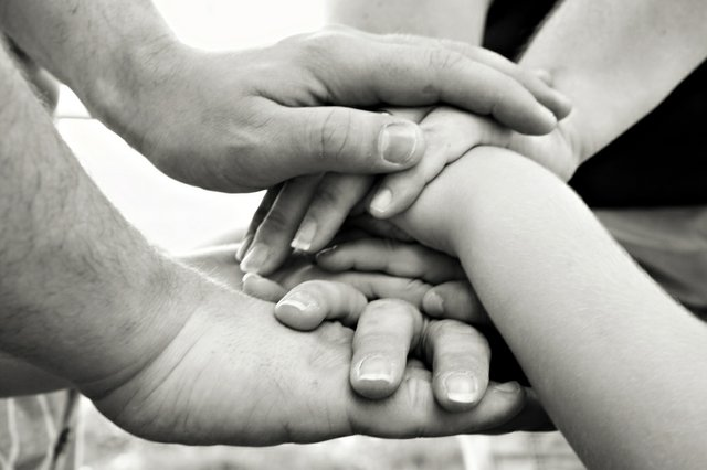 Family set of hands stacked