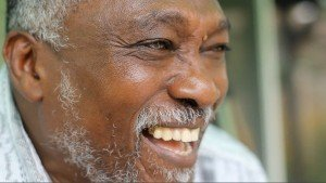 Face of older black man smiling