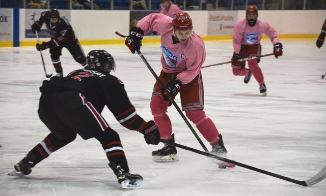 Ryan Garvey makes a move around an Icehawks defenseman prior to scoring a goal.