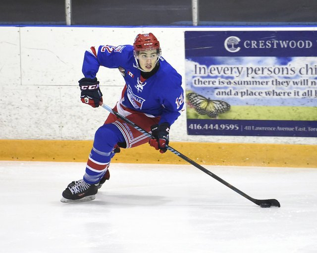 Dec 6, 2015 : Ontario Junior Hockey League game action between Oakville and St. Michael's, Ryan Foss #12 of the Oakville Blades skates with the puck during the third period.