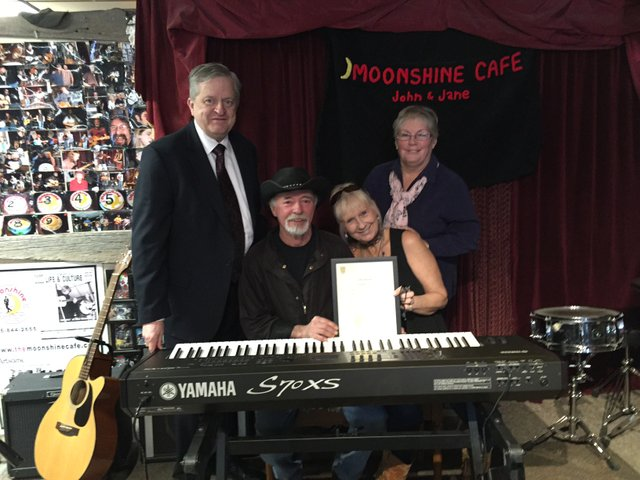 Mayor Rob Burton, Moonshine Owners: John  &  Jayne Marlatt, and Ward 2 Town and Regional Councillor Cathy Duddeck. behind an electronic keyboard
