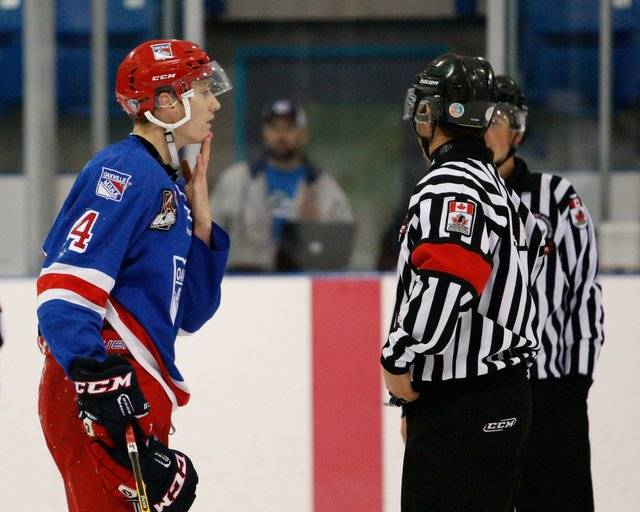 Hockey Player talking to Ref