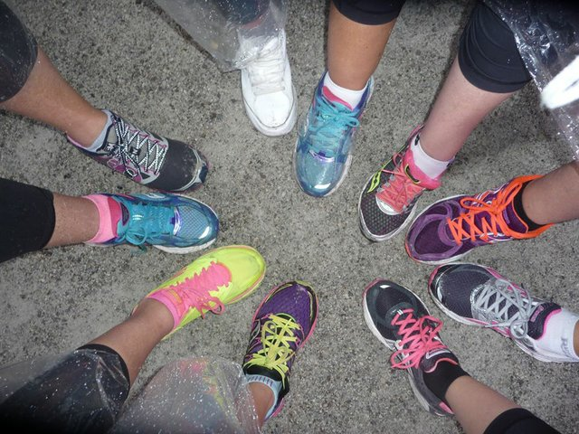 running shoes pointing into a circle