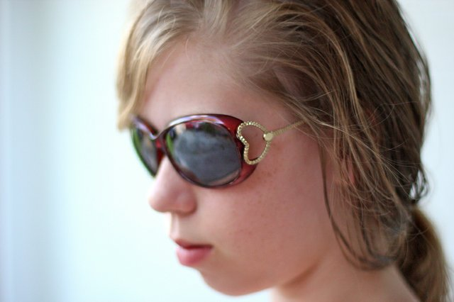 Head of young lady with sunglasses on