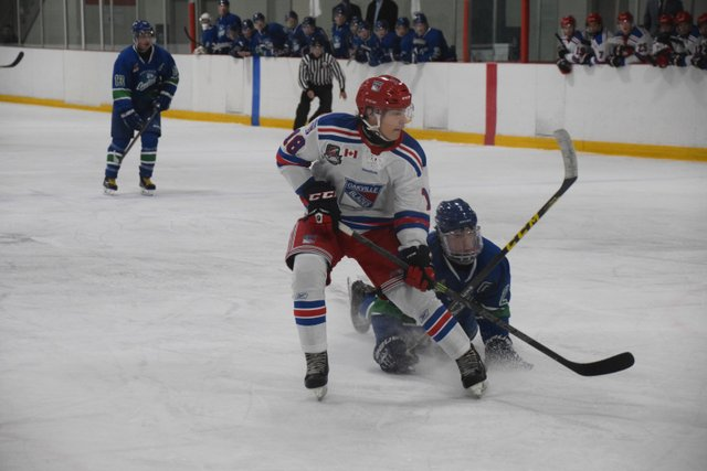 Bryce Misley out muscles a Burlington defender.