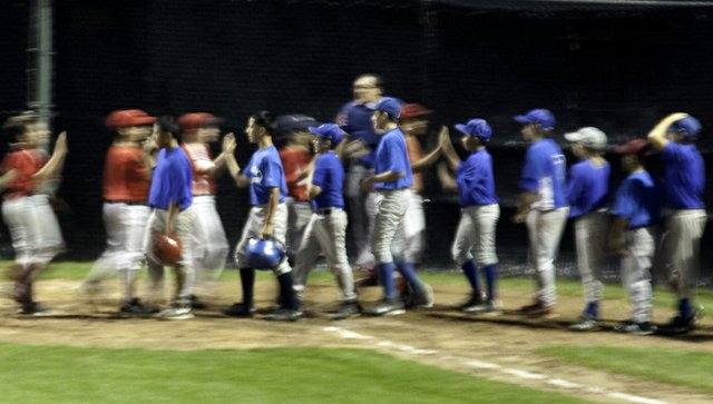 Baseball Team shaking hands with their opponents after a game
