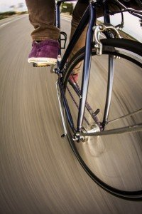 Close up of front wheel of a bicycle moving