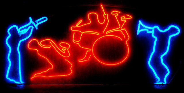 Jazz players outlined in neon light