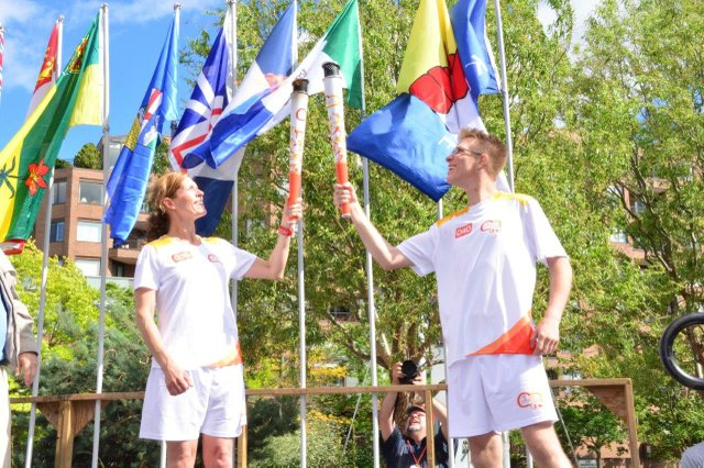 torch bearers with flags behind