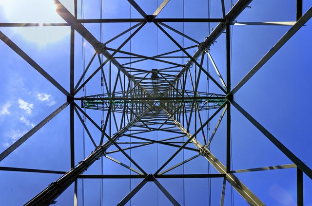 looking up directly under a transmission tower