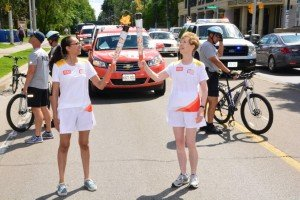 Torch bearers two women on a road