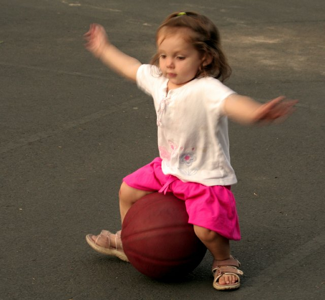Child playing with a ball