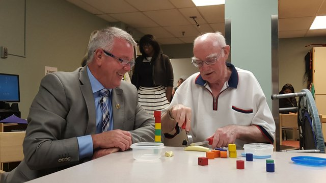 Alex Tough, a patient in the Step-Up program and MPP Kevin Flynn