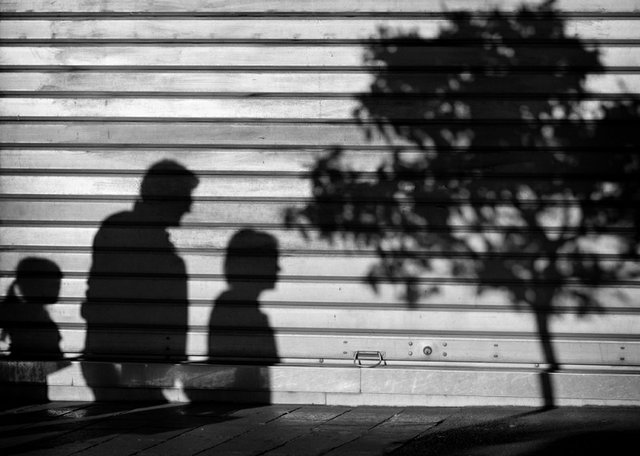Family shadow on a wall