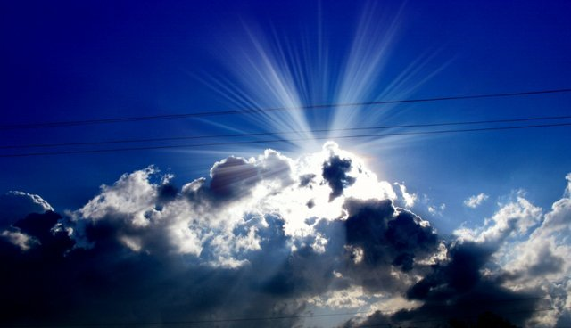 Sun rays about a cloud