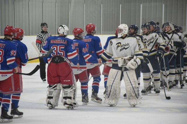 Toronto Patriots shake hands at the end of the game against the Oakville Blades