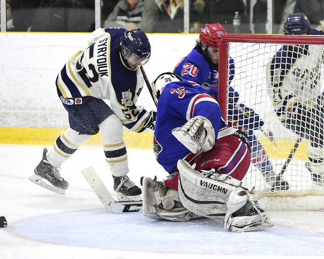 Ontario Junior Hockey League game action between the Toronto Lakeshore Patriots and the Oakville Blades. Game number 1 of the Semi-Finals series. Quinn Syrydiuk #52 of the Toronto Patriots battles for the puck with Daniel Mannella #35 of the Oakville Blad
