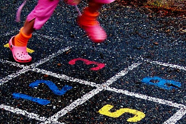 Child playing Hop Scotch