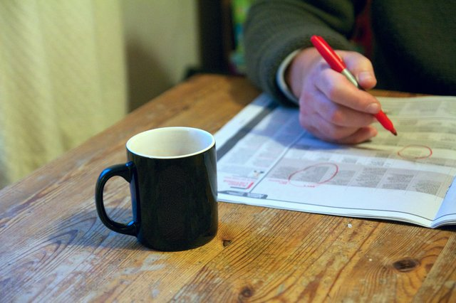 Job Search with Coffee, Newspaper  &  Red Pen