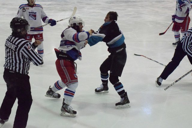Vince Palermo goes at it with a Lindsay Muskies player late in the third period.