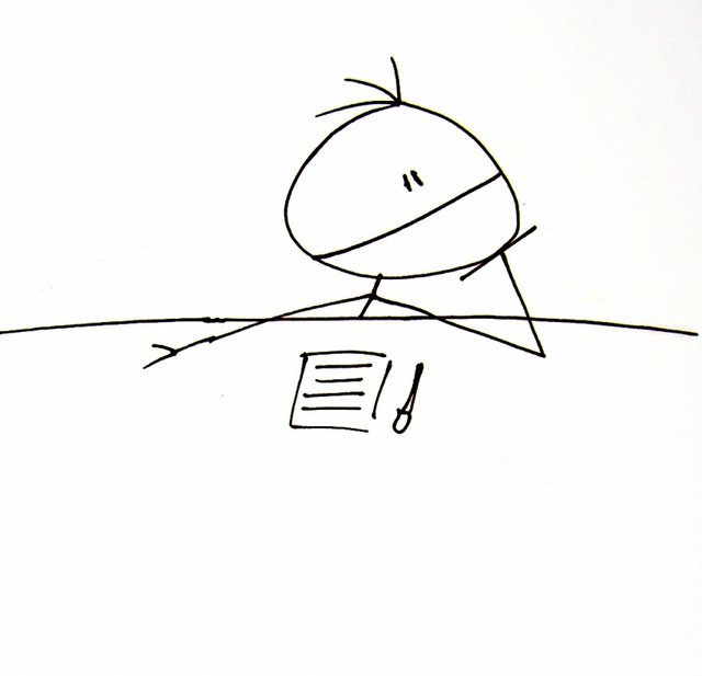 Line Drawing - of stick figure at desk with note pad and pen