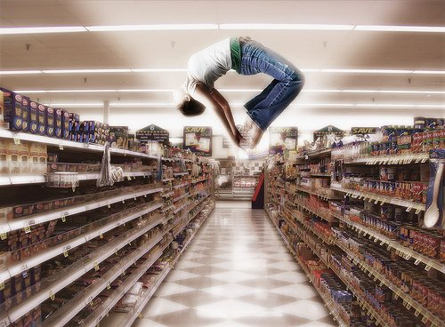 Gymnast doing a flip in a grocery store