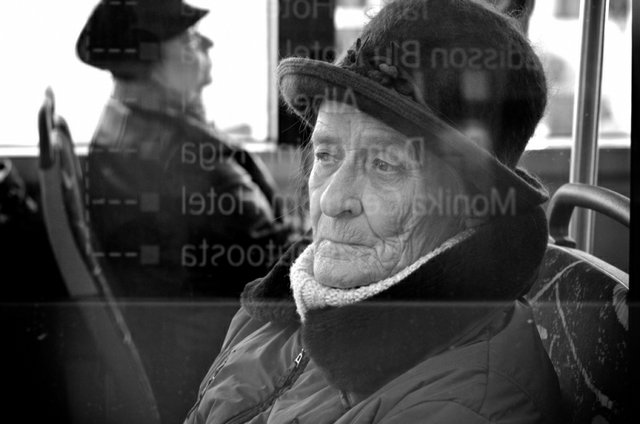 Elderly Lady looking out a bus window