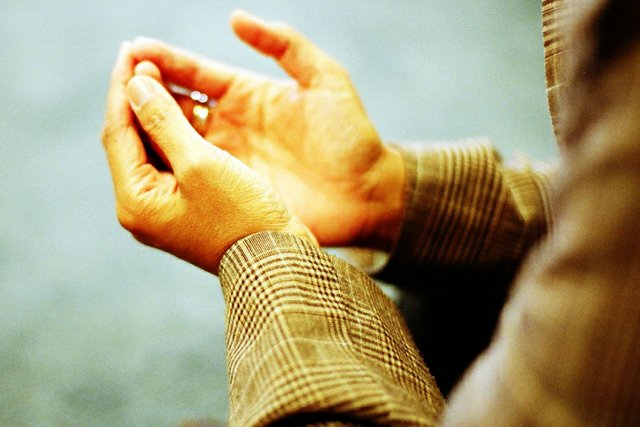 a cupping of hands in muslim prayer
