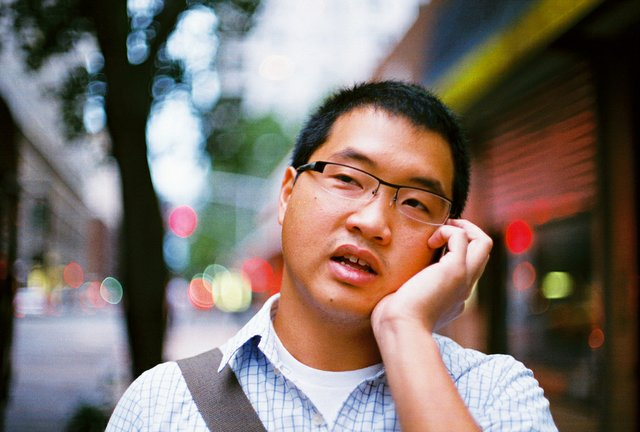 Chinese man answering his cell phone