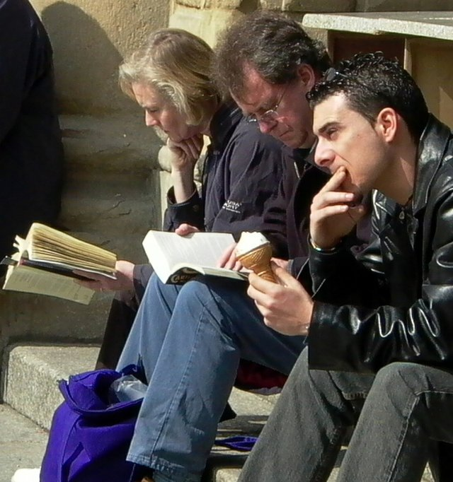People on steps outside reading