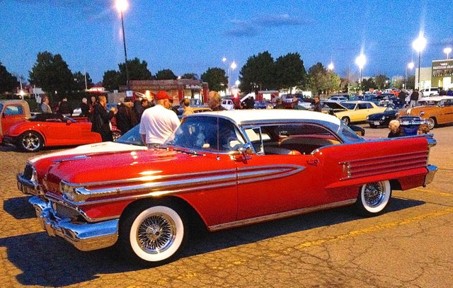 Classic car from the 50's, bright red with white top