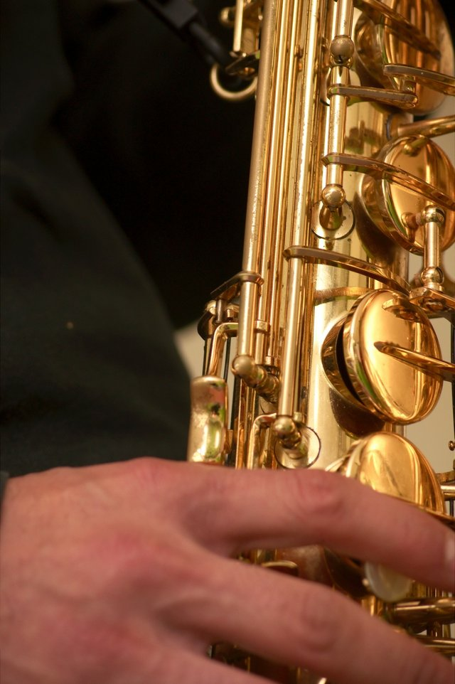 Close up of hands on a Saxophone
