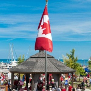 canadian flag flying over the Bronte Gazebo for Canada Day in Oakville