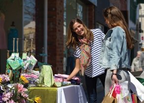 Ladies shopping at a sidewalk sale in Downtown Oakville
