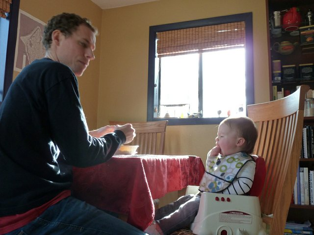 dad feed his infant breakfast
