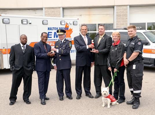 """Left to right: David Mayers, Ozone Systems International; Alpha King, Ozone Systems International; Greg Sage, Halton Region Paramedic Chief; Gary Carr, Halton Region Chair; Tim Bauer, St. John Ambulance; Gail Rogers with """"Cookie"""" the guide dog, St. John A"""