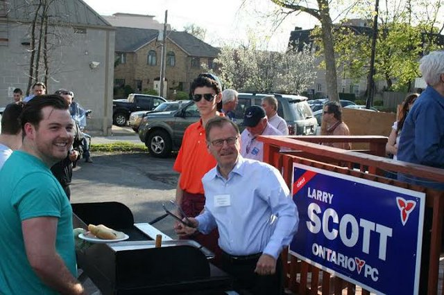 Larry Scott serving at his BBQ